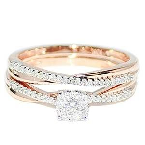 Rose Gold Diamond Engagement Ring Bridal Set - The most beautiful color on a ring iced with white gemstones makes it so sweet with this gorgeous Rose Gold Diamond Engagement Ring Bridal Set stamped in 10k Rose Gold placed within a Pave setting featuring a Round cut White center stone along with White Round accent stones on the top of the shank and the matching band. The Rose Gold Diamond Engagement Ring Bridal Set has a total gem weight of .25 carats with an I2-I3 in clarity and all of the…