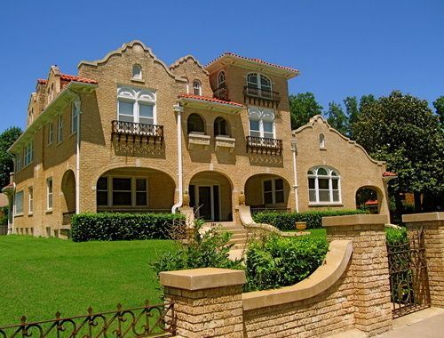 spanish style house deep front porch with arches balconies for upper bedrooms brick - Spanish Style Homes