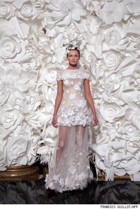 Chanel paper flower backdrop. Love this.