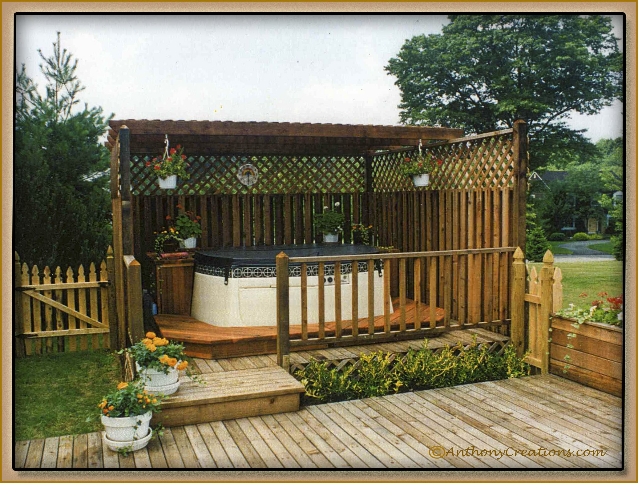 above ground tub on deck with pergola plus tall fence and
