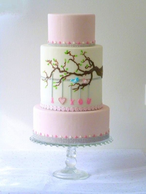 birds in tree with pink baby shower cake