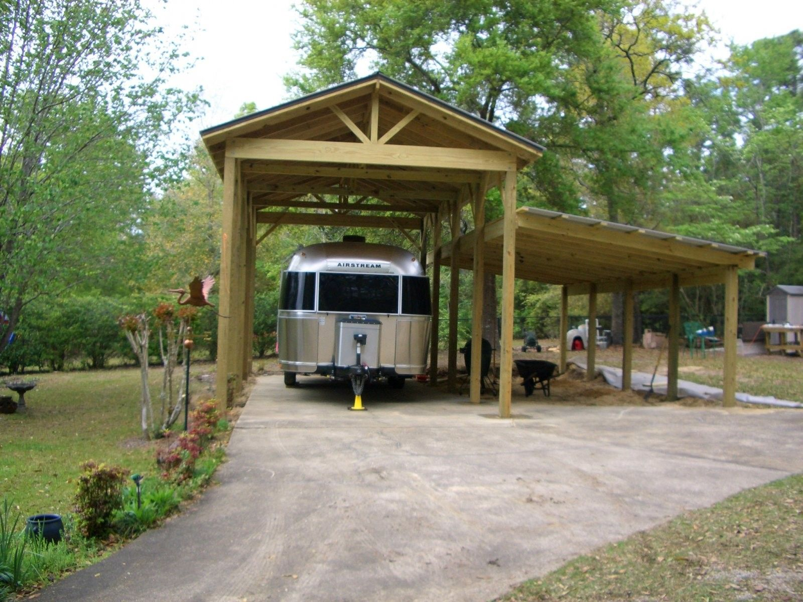 Costco Carport covers an open platform (10x20) for tent