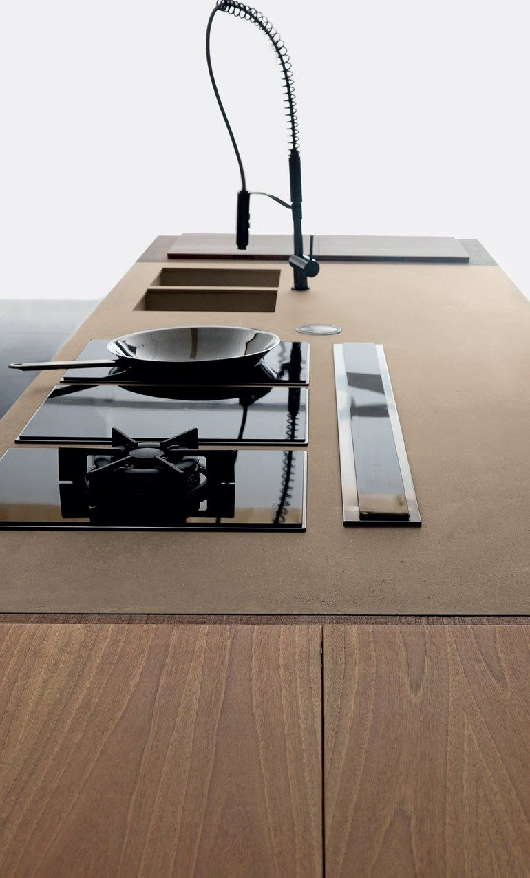 Super sleek, minimalist island unit in olive wood. Pop up extractor and individual gas wok hob. Perfection! www.mountshill.com