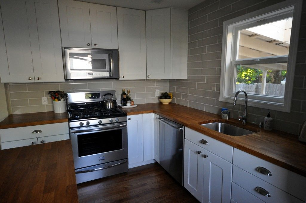 White Cabinets Gray Subway Tile And Butcher Block