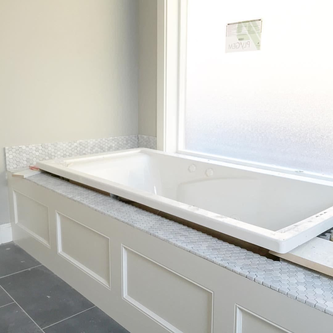 White Jetted Tub With Carrara Hexagon Honeycomb Backsplash