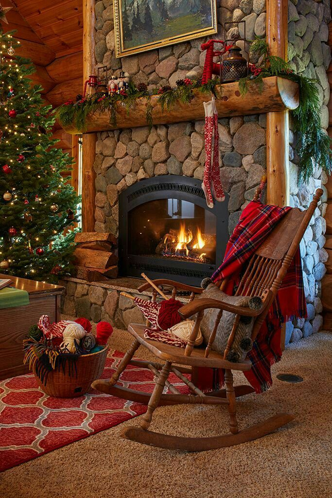 A Cozy Fire A Rocking Chair With A Blanket And Pretty Christmas Decor Cabin Christmas Christmas Fireplace Cozy Christmas