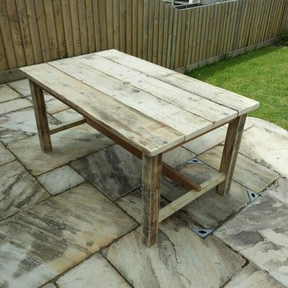Garden Table From Reclaimed Scaffolding Boards And Fence Posts On