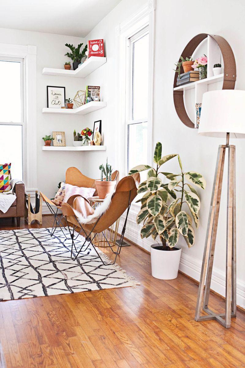 floating corner shelves; butterfly chairs; tripod lamp; ABM living ...