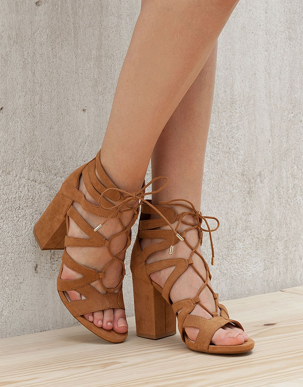 Tied heeled sandals. Discover this and many more items in Bershka with new  products every