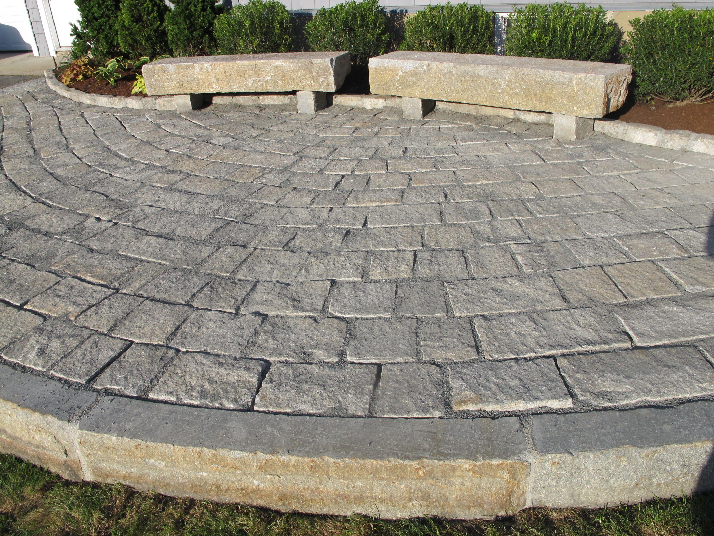 Reclaimed Granite Pavers Curbing Used In This Raised Patio - Granite patio pavers
