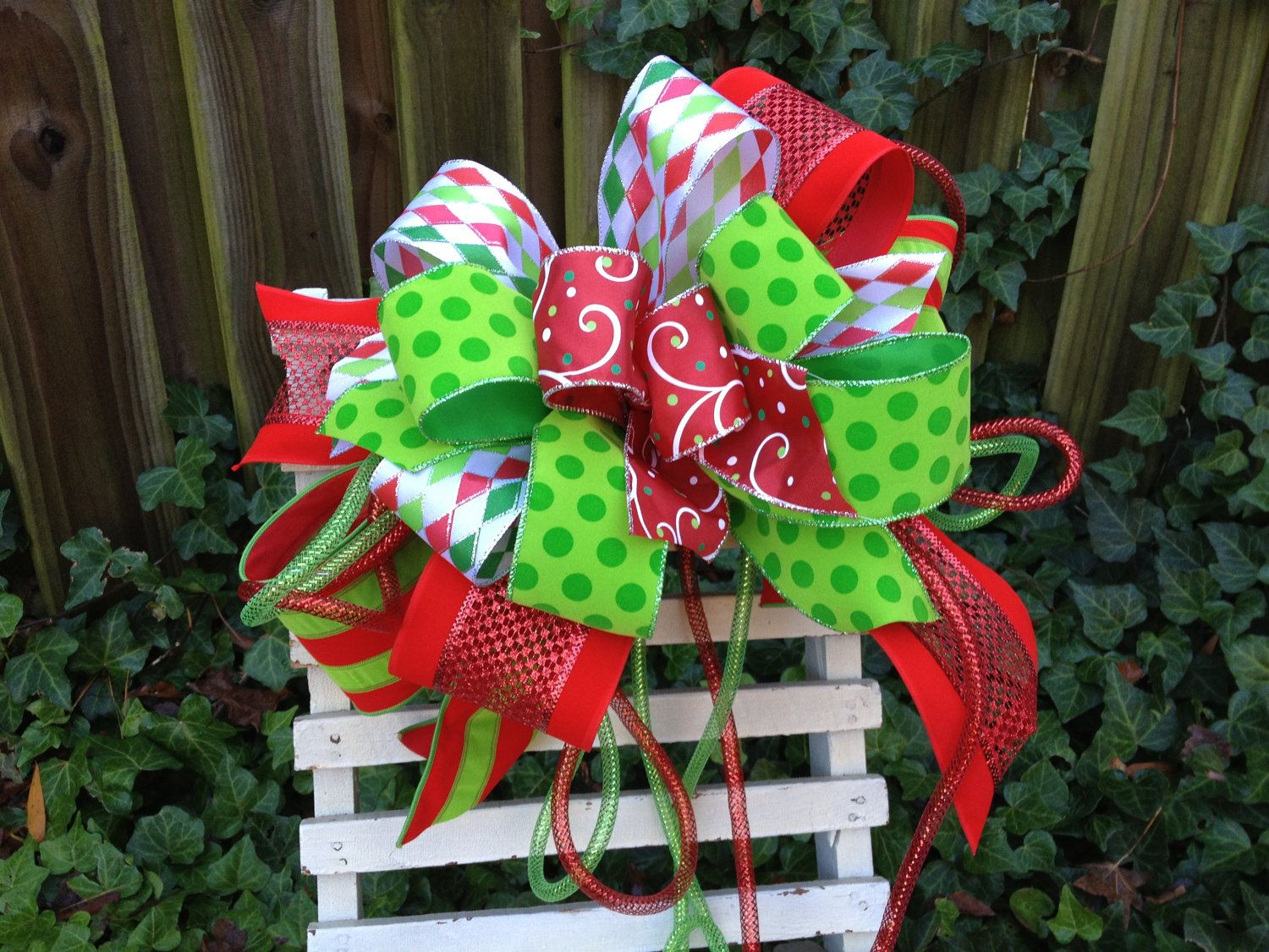 christmas tree topper christmas bow by theholidaybowtique 3500 christmas tree with mesh diy christmas