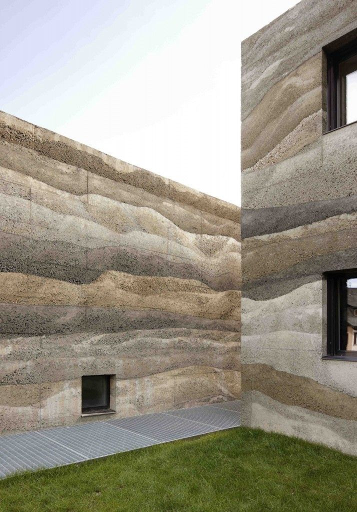 Dyed Stamped Concrete Walls Of Giardin Housing Complex Designed By Kurt Mierta Lazzarini Architekten Architecture Facade Architecture Rammed Earth Homes