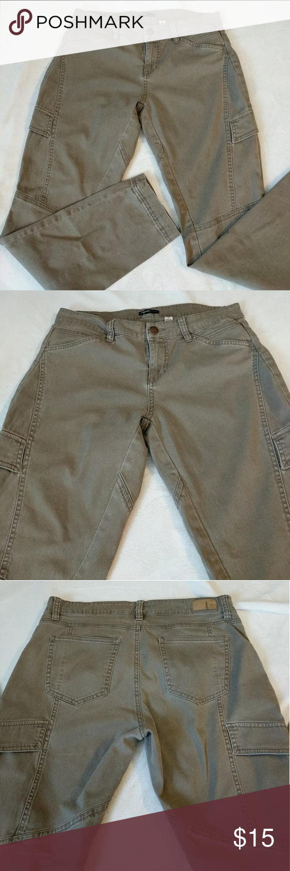 Army Green Cargo Pants Size 10.  These cargo pants are perfect for that casual cool vibe!  Cuff up the bottom hem and pair with your favorite boots for a great look!  Features side cargo pockets and a diagonal inseam for a slimming look!  Small stress holes on both legs where pocket flap is attached to pant ( see last pic) otherwise great condition!  Flat lay measurements Inseam: 28.5