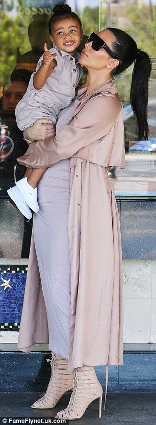 Pregnant Kim Kardashian's $4500 Lanvin coat ruined by North West's popcorn | Daily Mail Online