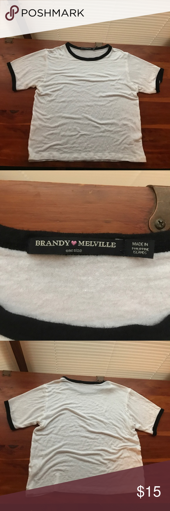 Brandy Melville Ringer Tee White and black Brandy Melville Ringer Tee. Worn a few times and in great condition! Black lining around collar and ends of sleeves. offers welcome! Brandy Melville Tops
