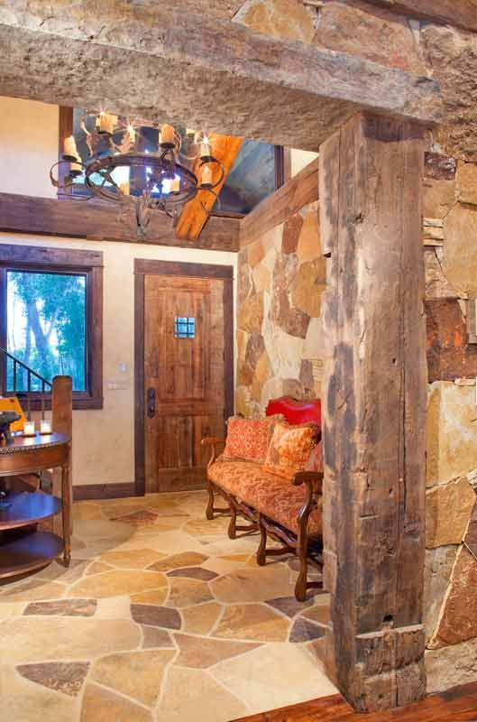 Reclaimed Timber Home - Timber Home Living.  Love the rock walls!