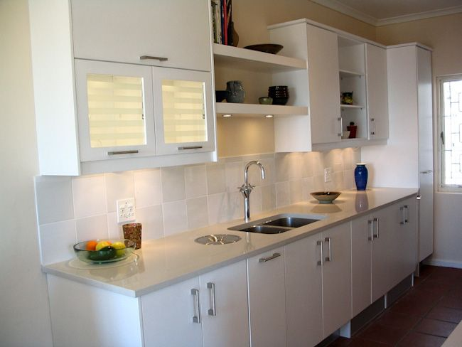 open shelving above sink area and lighting under the cabinets ...