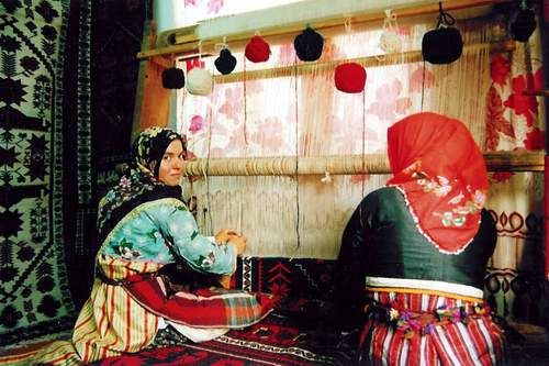 Women In Iran Hand Weaving A Modern But Dyed And Woven Oriental