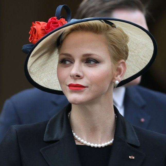 Princess Charlene wore a 1950s-inspired hat, perhaps a nod to her late mother-in-law, silver screen star Grace Kelly
