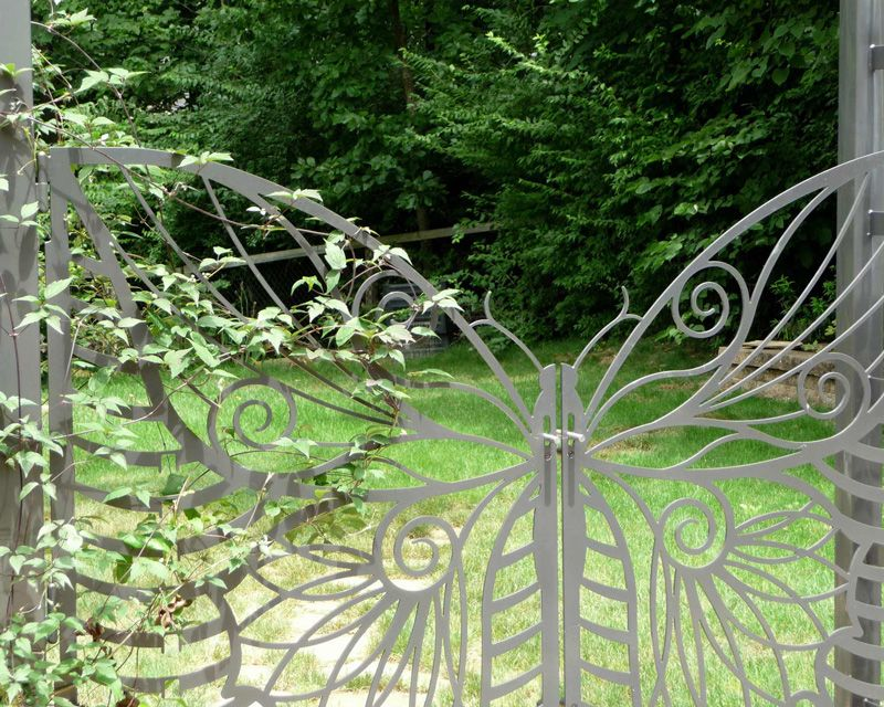 Garden arbor with gate butterfly gates and arbor make a for Garden gate arbors designs