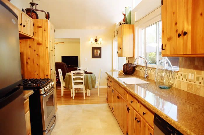 Refinished Knotty Pine Cabinets I Like The Black Hardware Note These Tan Counters Don 39 T Clash