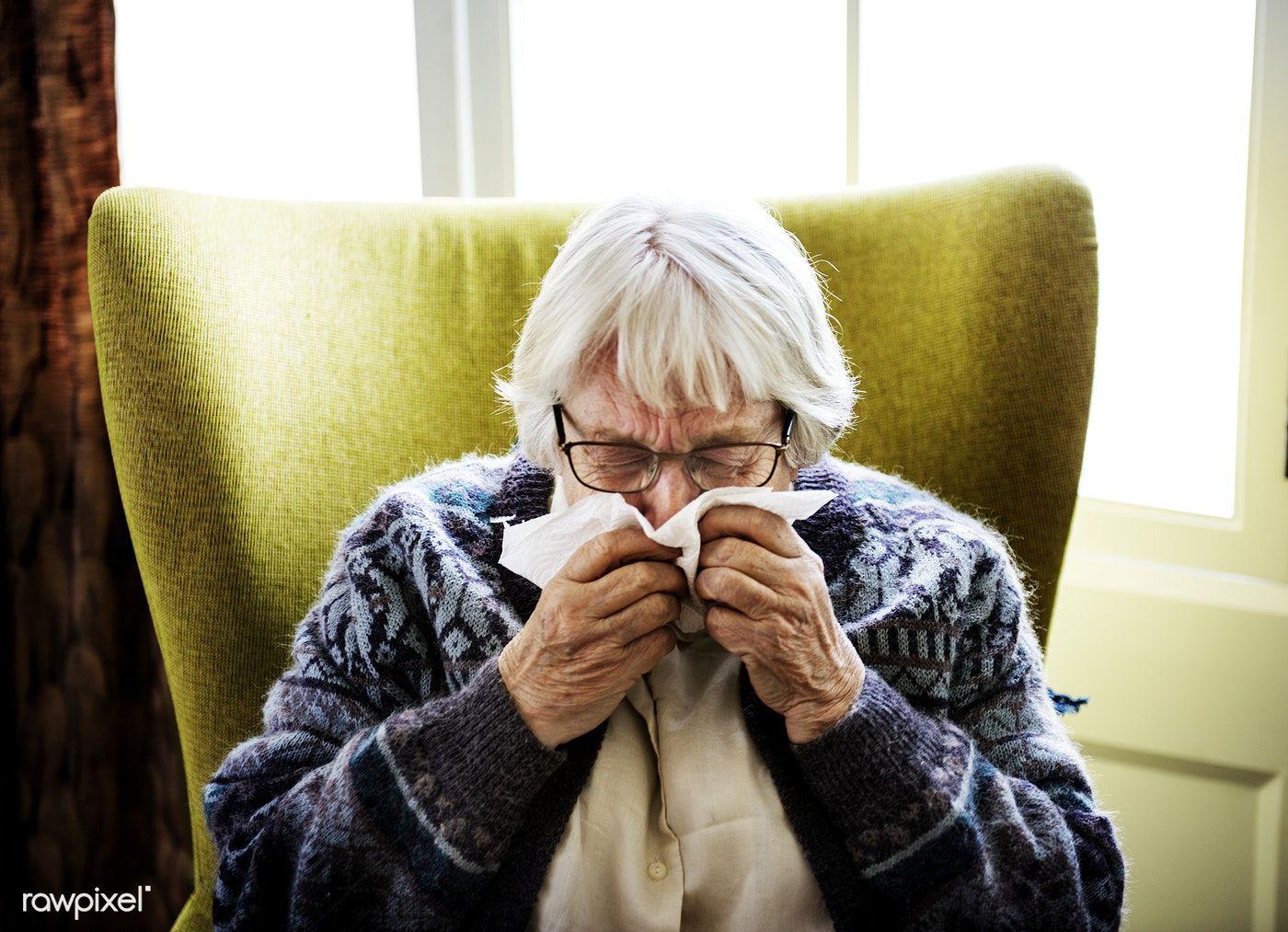 Download premium image of Senior woman sneezing 378785