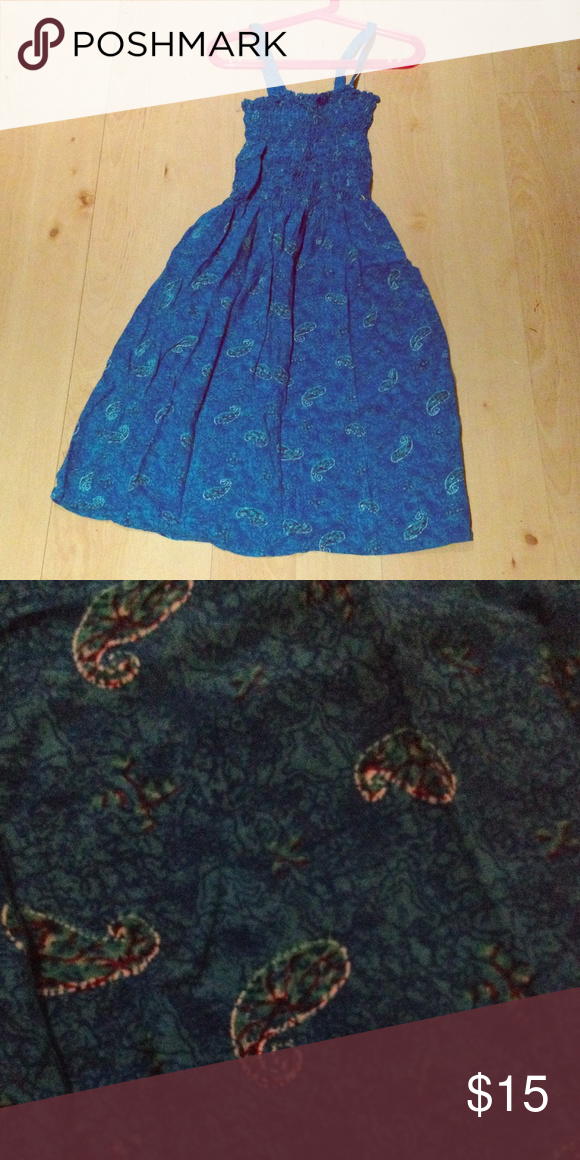 Blue summer dress Side pocket on the right. 55% Cotton & 45% Rayon. Fitted top. Light blue designs. Can fit size S-M since fitted. Dresses