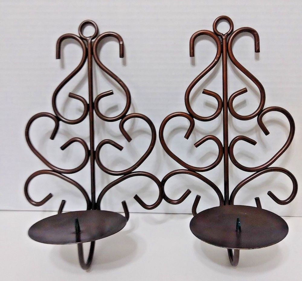 Set of browncopper looking pillar candle wall holders