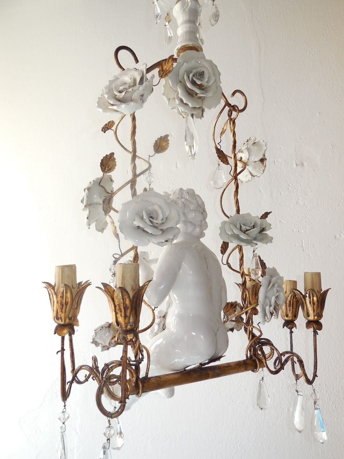 French porcelain roses and tole with huge cherub swinging chandelier french porcelain roses and tole with huge cherub swinging chandelier arubaitofo Choice Image