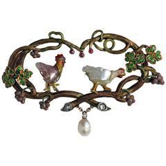 WILHELM LUCAS VON CRANACH 1861-1918 Symbolist Brooch The Cockerel & The Hen. Gold, enamel, Demantoid garnet, Ruby, Pearl