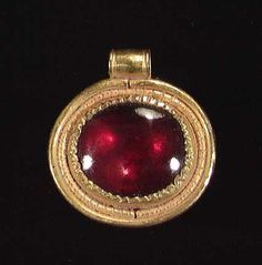 A roman gold pendant ca 1st 3rd century ad oval in form set with a roman gold pendant ca oval in form set with a large garnet cabochon aloadofball Images