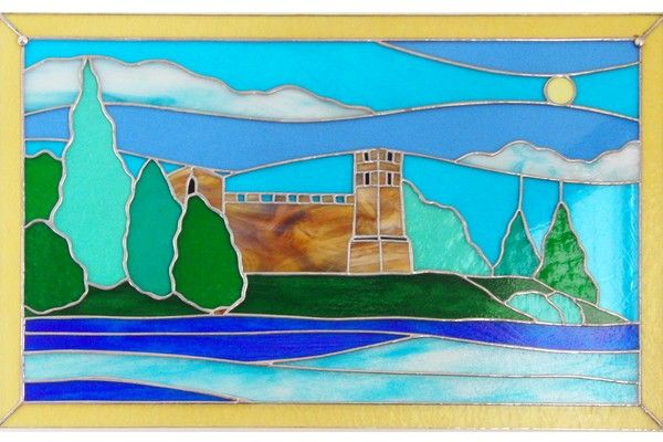 Wall painting handmade Tiffany technique. The landscape depicts the view of the walls of a castle surrounded by greenery of trees and bushes. The effect given by combinations of green and blue colours is of natural serenity. The picture is provided with wooden frame in shades of blue. This object is made entirely by hand and is therefore a unique piece and composition. This guarantees the originality and quality of craft product Made in Italy.
