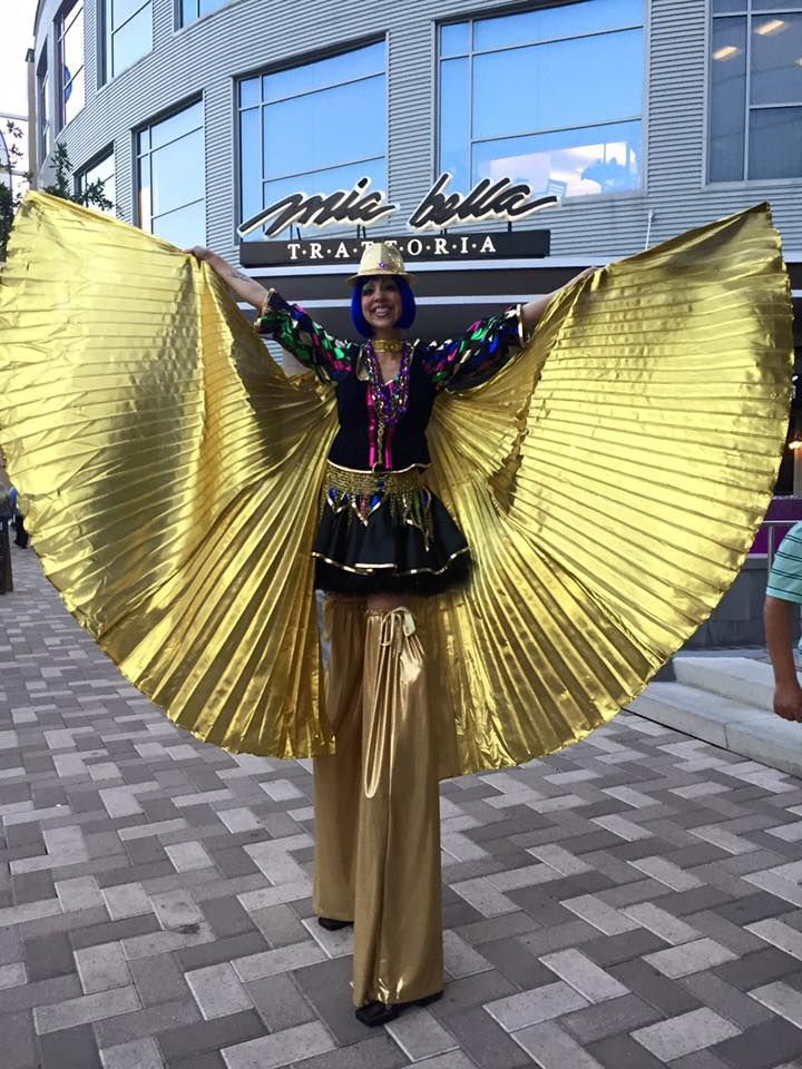 Mardi Gras themed stilt girl provided by J&D Entertainment