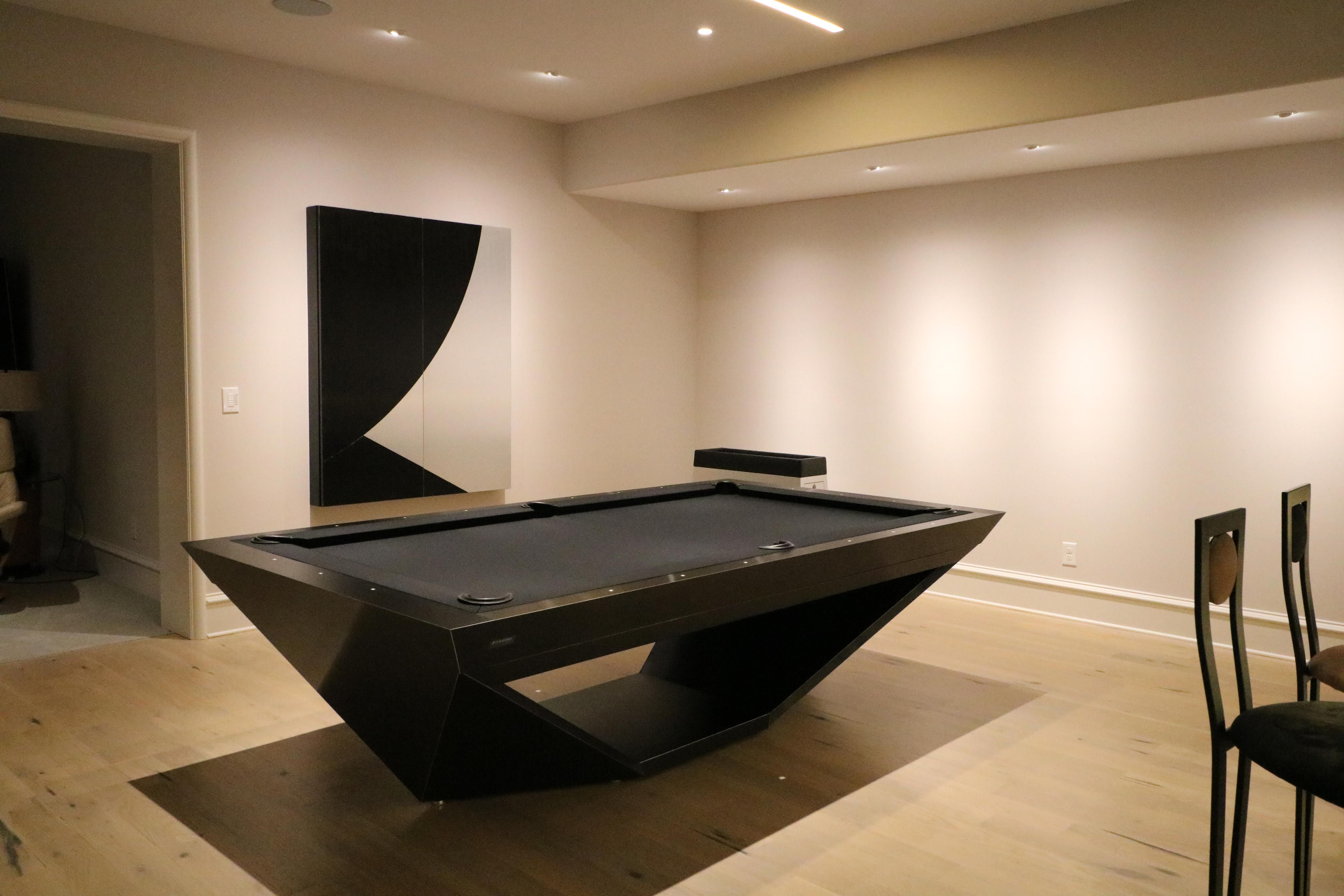 Drawing Influence From The Stealth Bomber Aircraft 11 Ravens Brings A Model That Is Precision Engineer Home Bar Designs Modern Pool Table Basement Bar Designs