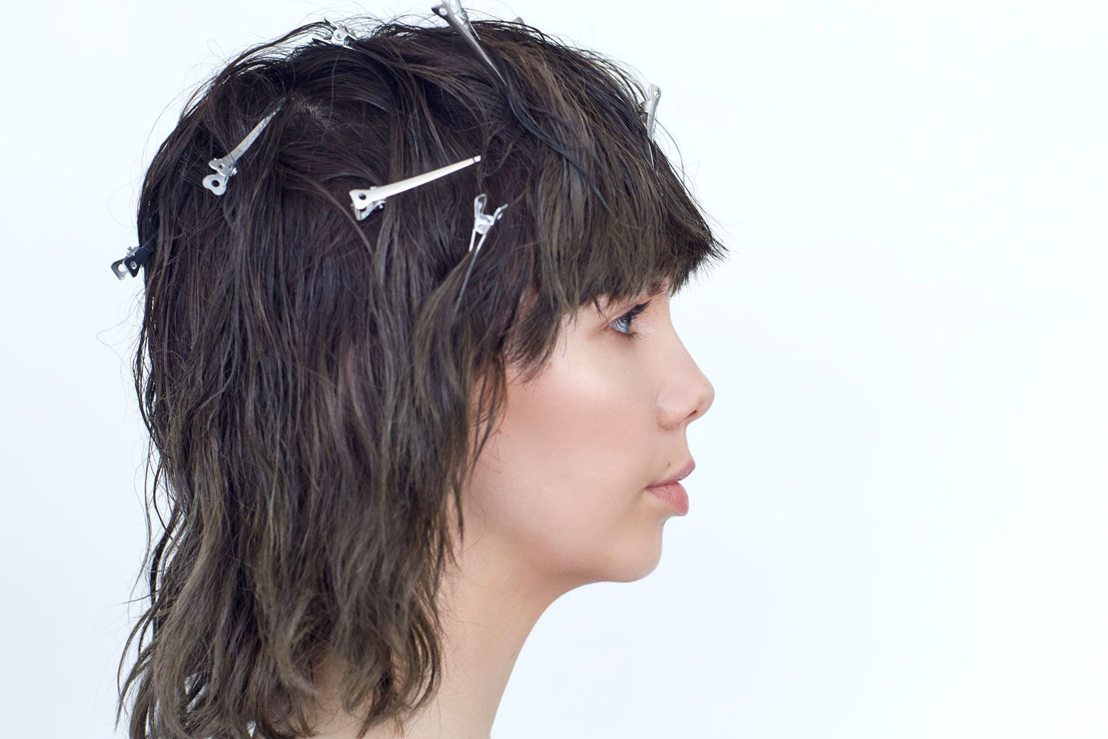 This particular style presented a challenge for Moore. When hair air-dries naturally, it can go flat up top, which is why Moore likes to use these clips to just create irregularities in the root for lift.Moore placed the clips randomly to make sure the hair sections dried in different directions to add truly imperfect texture. #refinery29 http://www.refinery29.com/air-dry-hair-tips-hairstory-stylists#slide-13