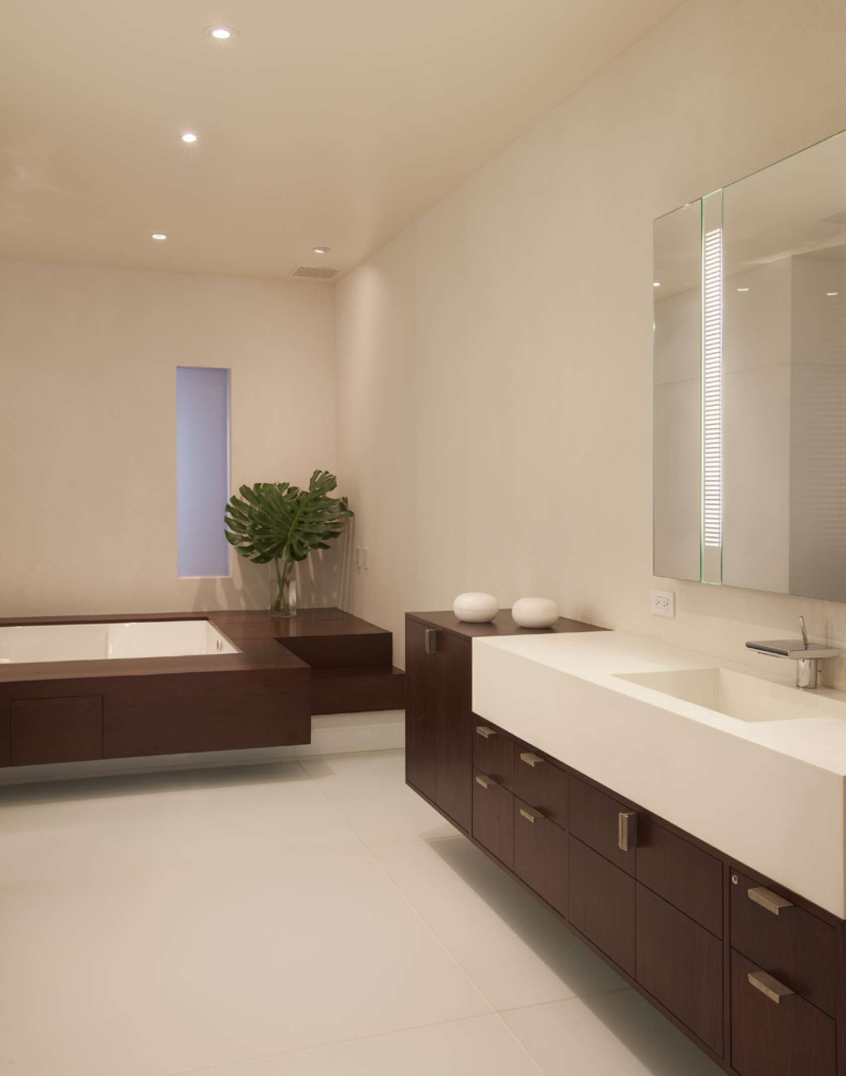 Clean contemporary bathroom design by SPG Architects featuring a ...