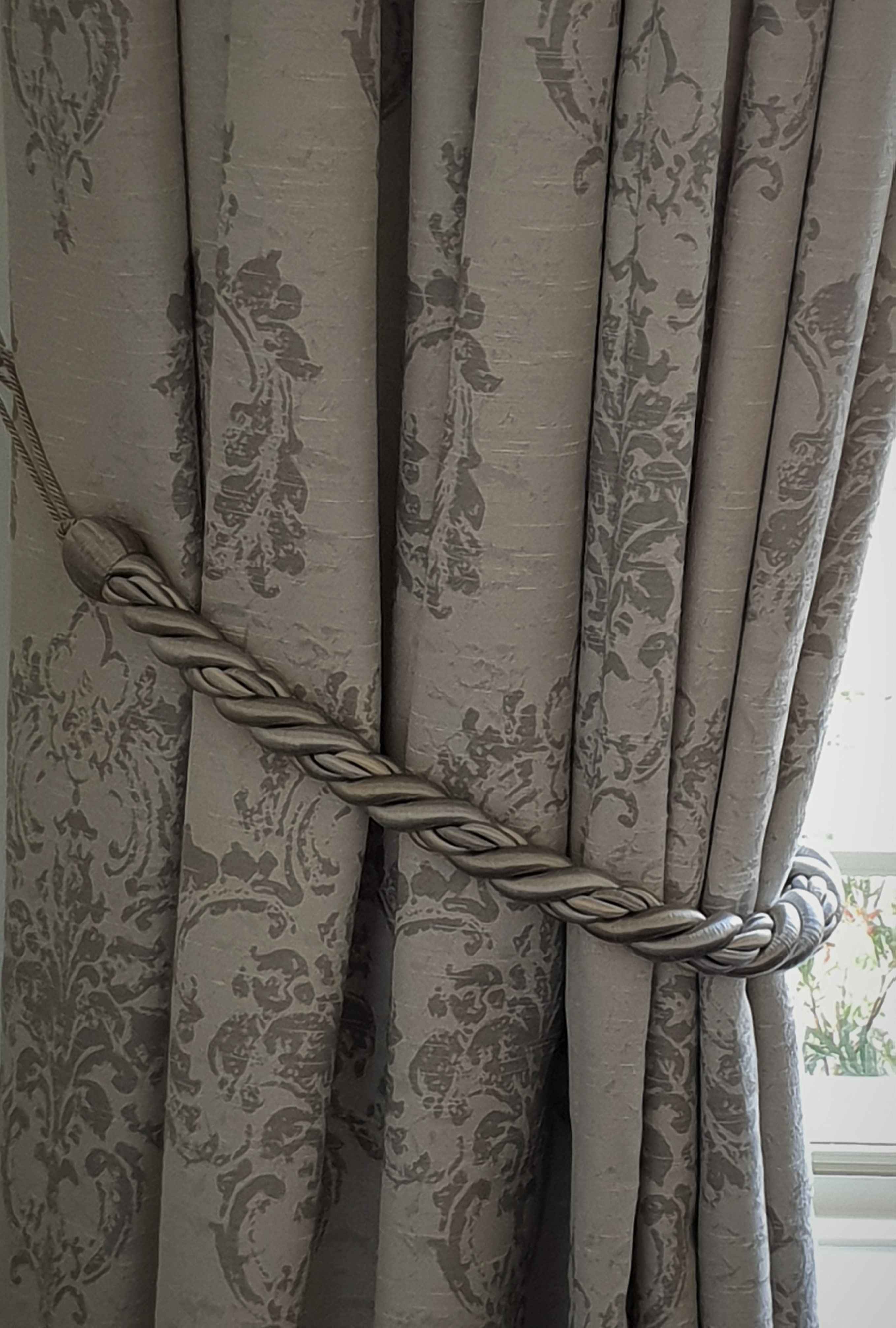 John Lewis tie-backs compliment the curtain fabric perfectly ... on
