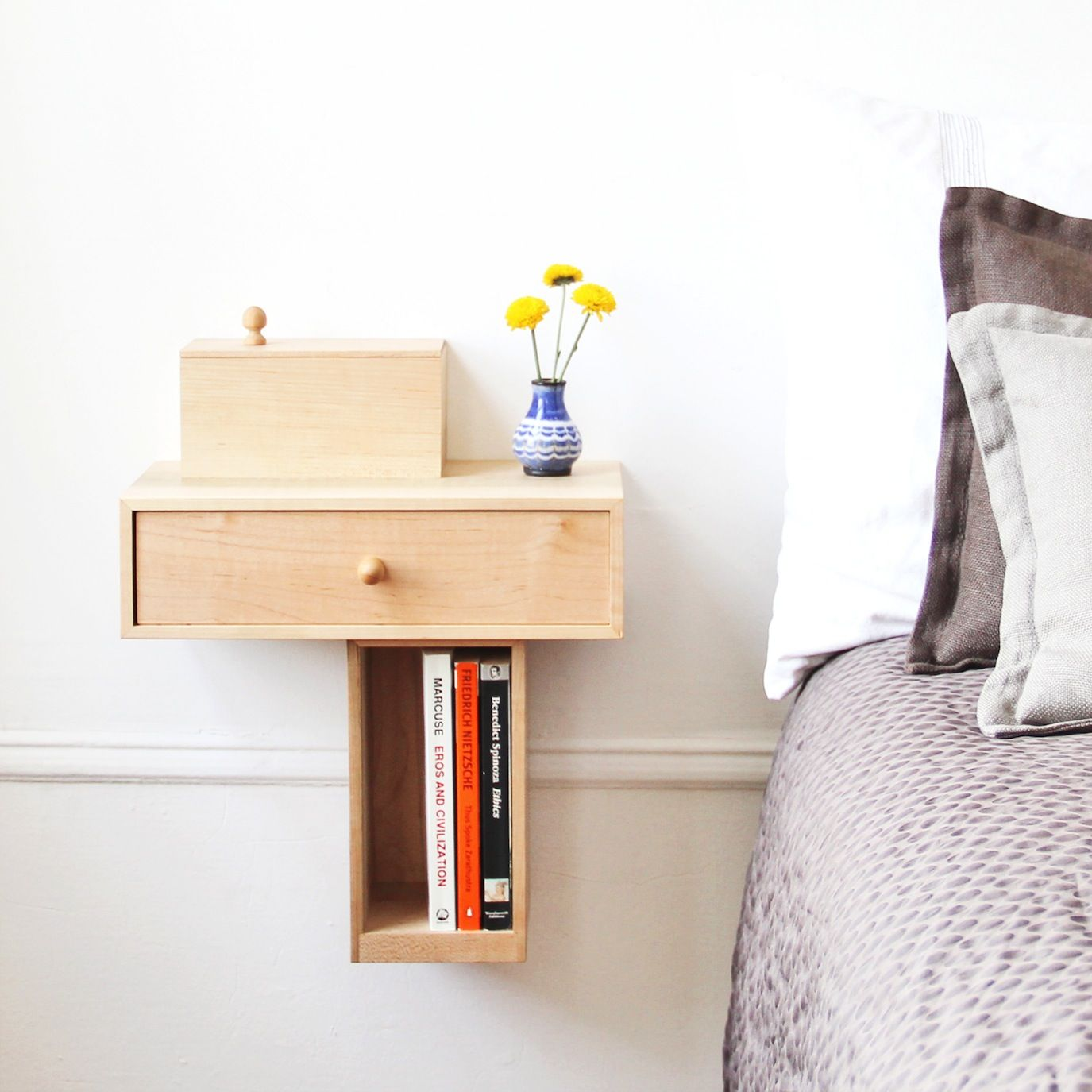 The traditional bedside table is a space hog that offers little storage in  return. For