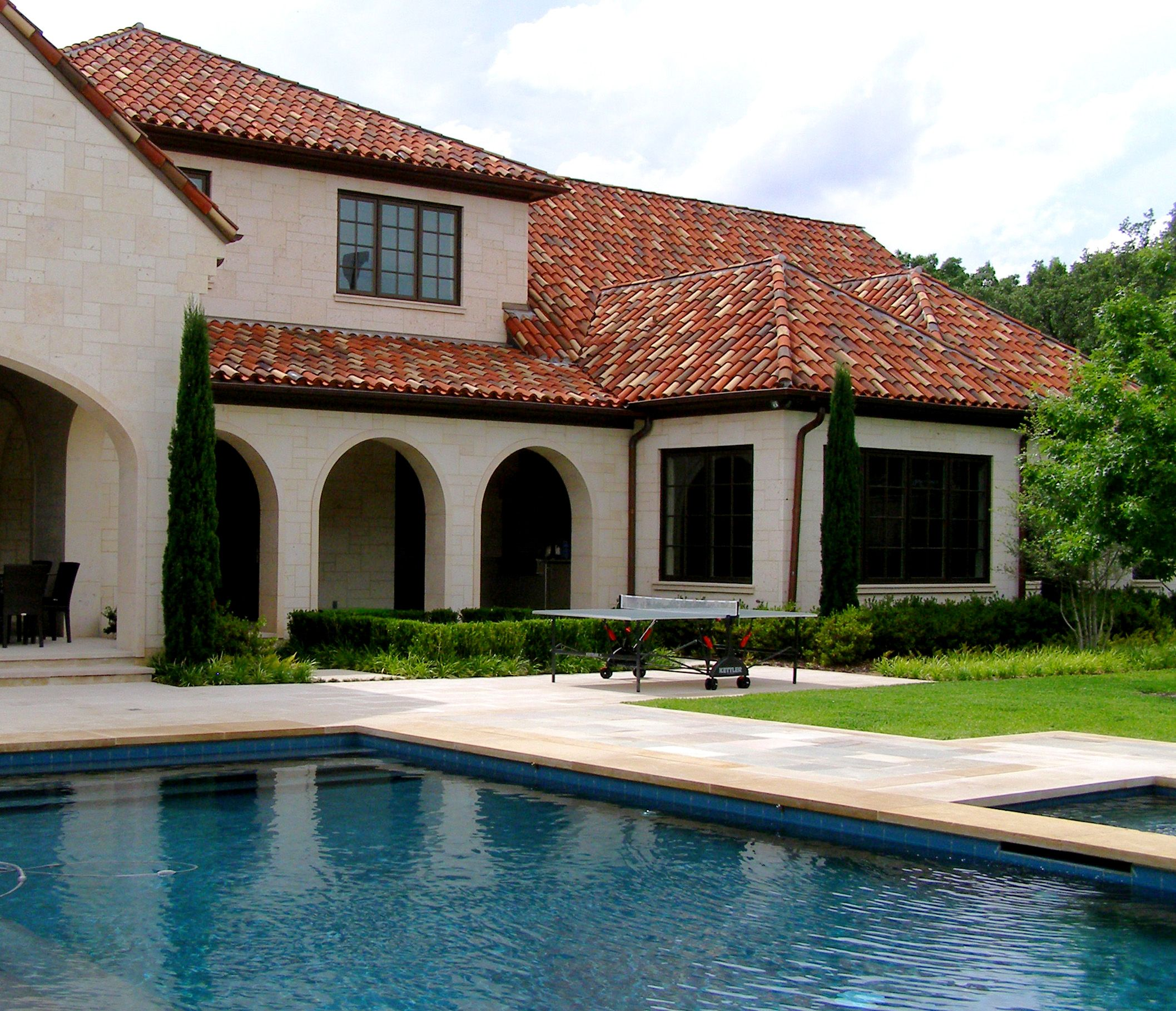 Backyard Exterior Of A Italian Mediterranean Villa In Dallas Tx With Multi Colored Terra Cotta