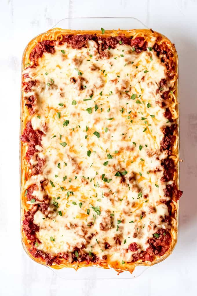 This cheesy baked spaghetti casserole is kid-friendly, filling, and perfect for feeding a crowd. Me