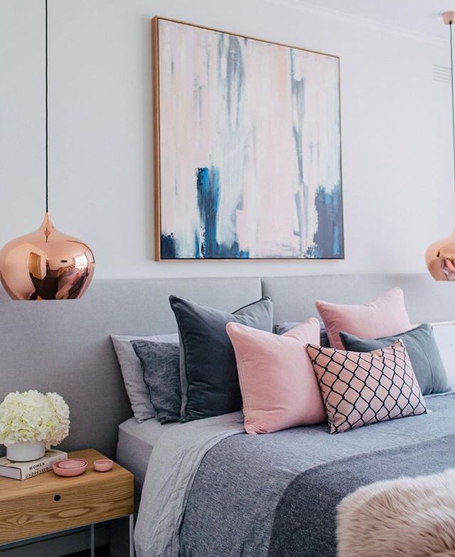 """Dig the oversized/abstract painting, and pendent lighting. A little too """"pink"""" for a uni-sex bedroom."""