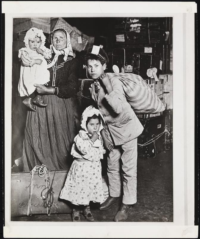 Immigrants on Ellis Island by Lewis Hine ca. 1905, Museum of the City of New York
