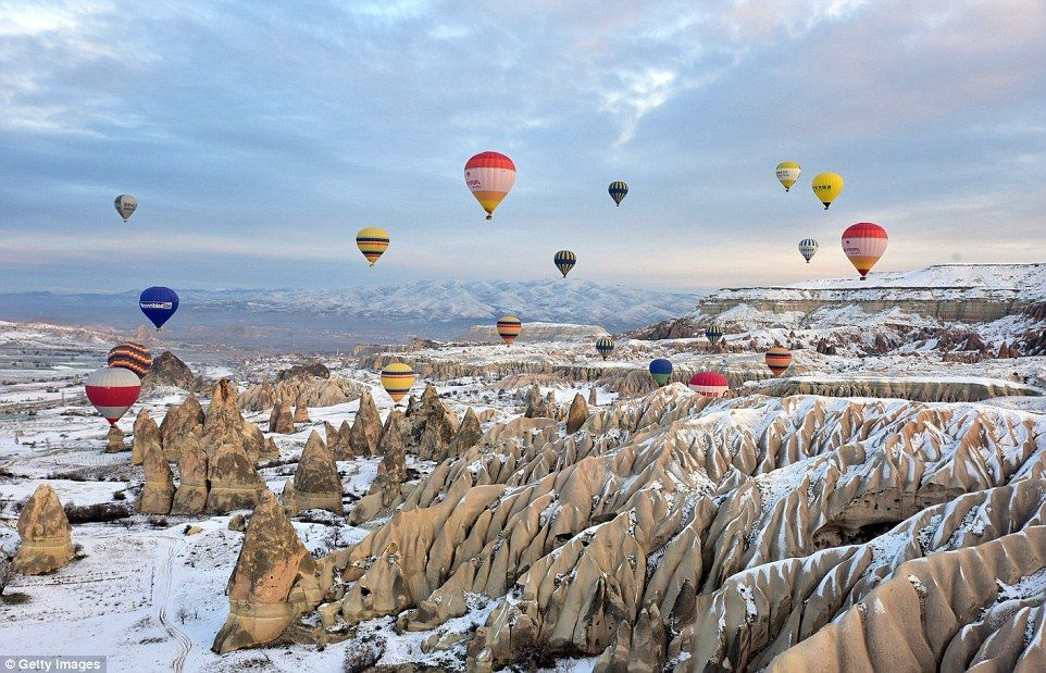 Hot air balloons flood the sky over Turkey's Cappadocia
