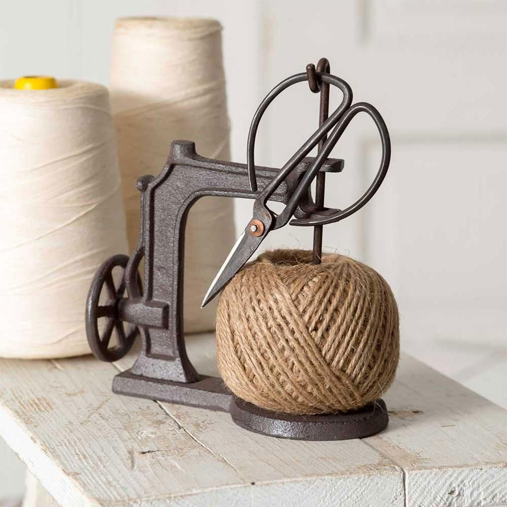 Add a vintage look to your craft room with our adorable Sewing Machine Twine Holder and Scissors. Measurement: 6''W x 3''D x 7''H