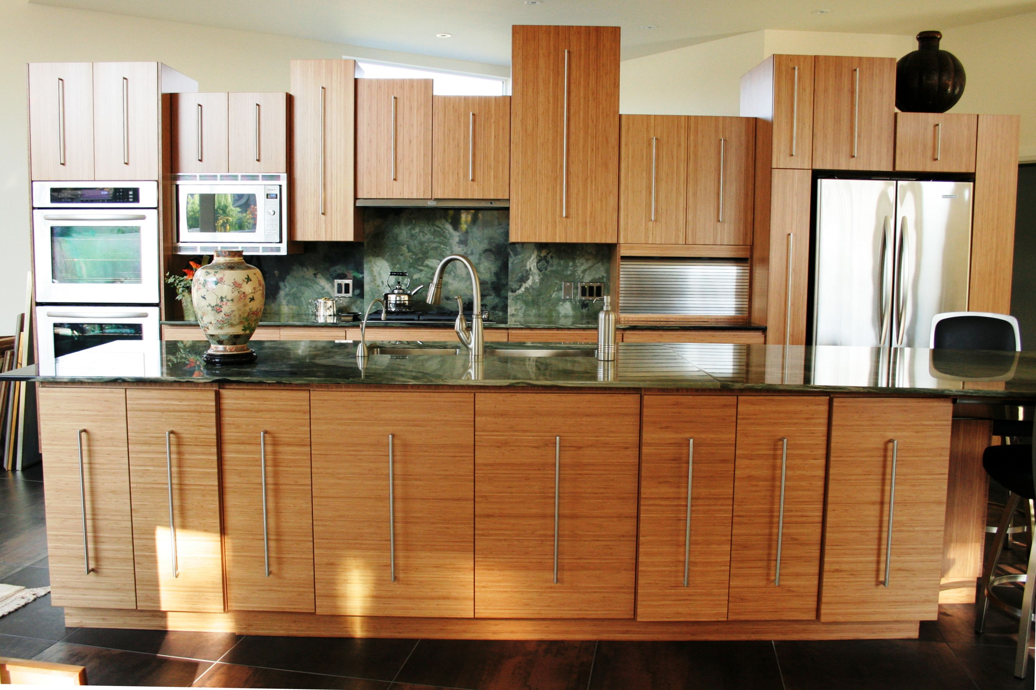 The home owner of this solid Bamboo kitchen wanted the doors to be all different sizes and different depths. A cool take on the modern kitchen.