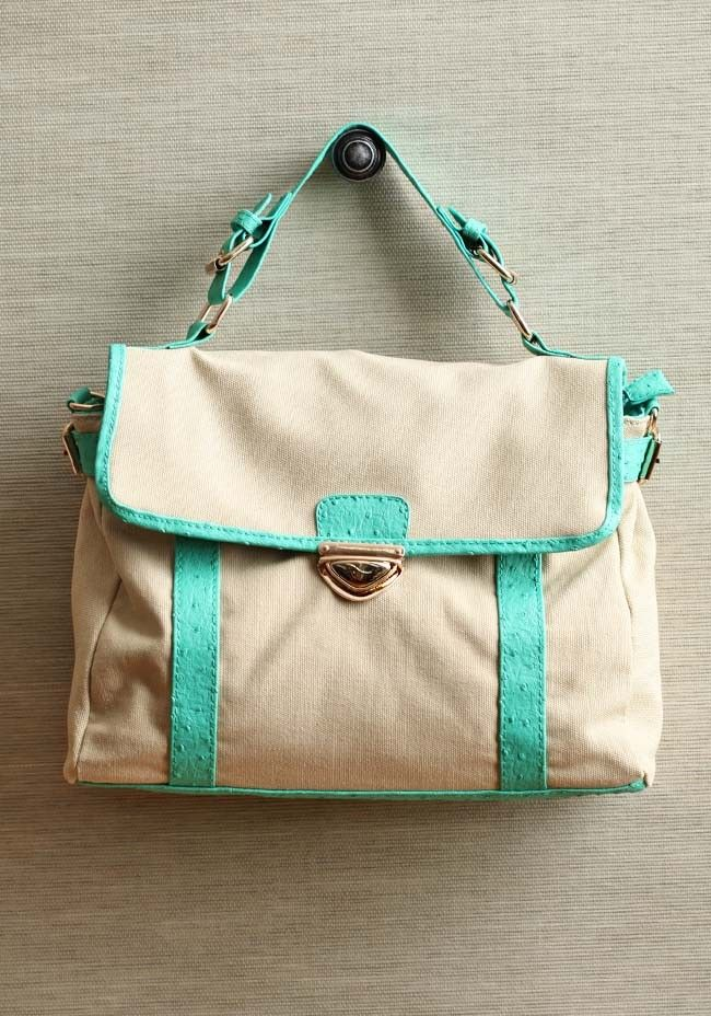 """Hint Of Mint Canvas Purse 44.99 at shopruche.com. Simple and elegant, this natural colored canvas bag is accented with mint green leatherette details and gold colored hardware. Finished with a large interior compartment, zipper closure, and optional shoulder strap.  Shell: 100% Cotton, Polyester: 100% Polyester, 12""""L x 9""""H x 3.5""""W, 1 inner zipper closure, 2 inner compartments, 5"""" strap drop"""