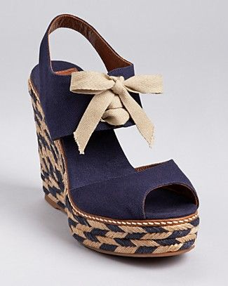 "Tory Burch Espadrilles - Linley High Wedge.A printed, woven wedge makes a bold statement below a canvas silhouette from Tory Burch, showcasing a chic tie detail and nautical inspired details. •4.75"" woven raffia wedge heel, 1.25"" platform"