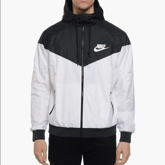 Black and White nike windbreaker Tags is woman's 3XL but it is equivalent to a male medium. New in bag. With tags. Sold out in stores and online  NO NEGATIVE COMMENTS ❌ I DO NOT TRADE  I ship next day  10% of bundles of 2 items or more  PRICE IS FIRM Nike Jackets & Coats