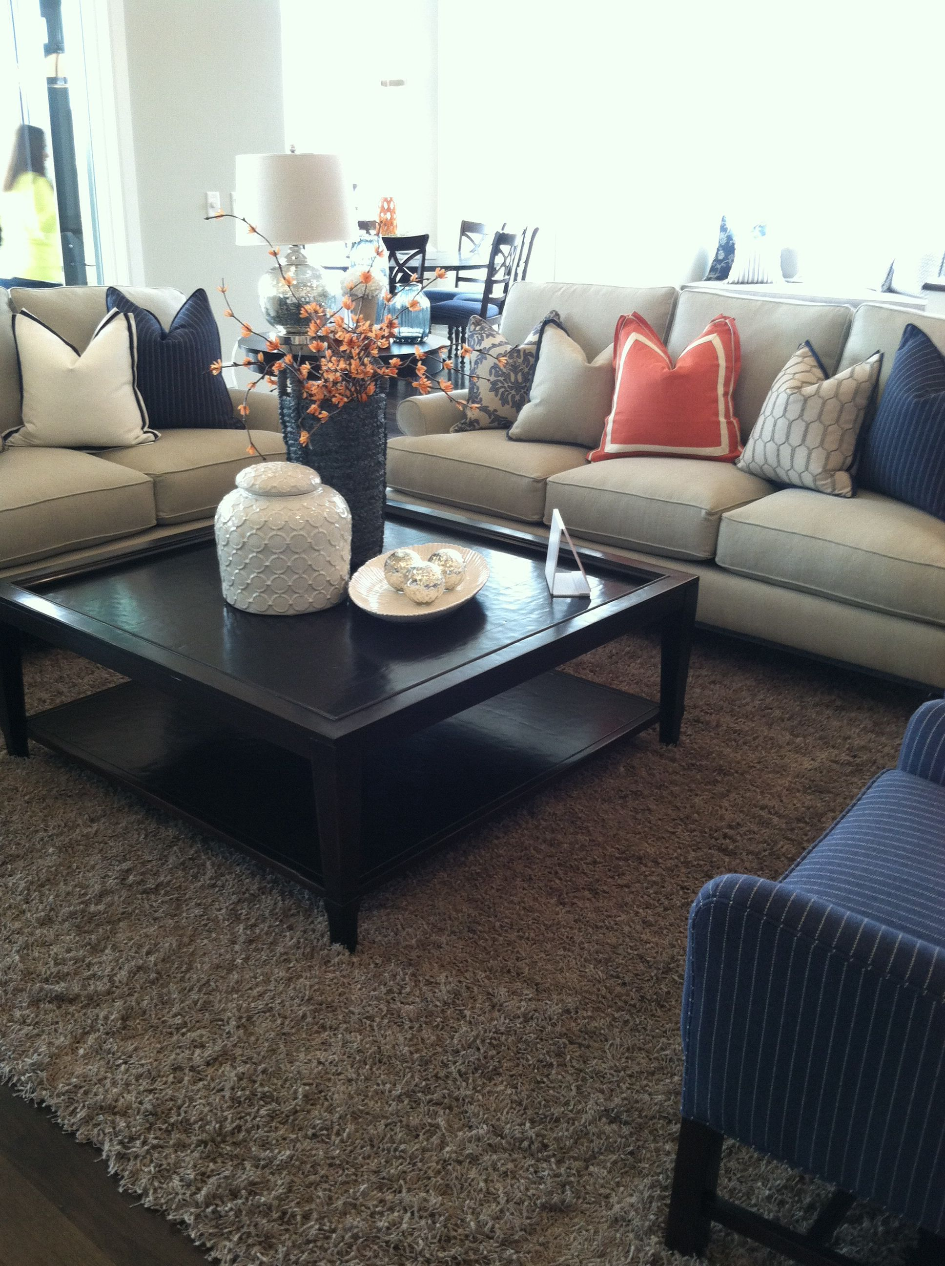 Orange and navy blue accent for family room looks so - Blue accent chairs for living room ...