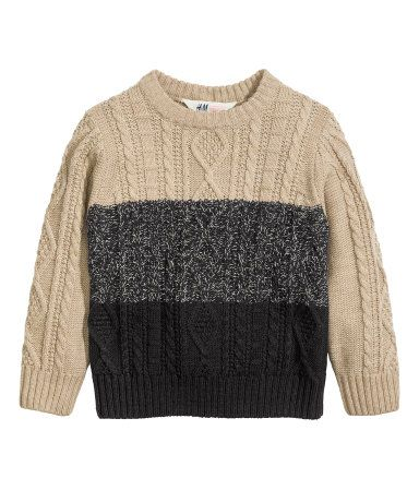 Cable-knit sweater in a cotton blend with a flat-knit back section. Rib-knit hem and cuffs.